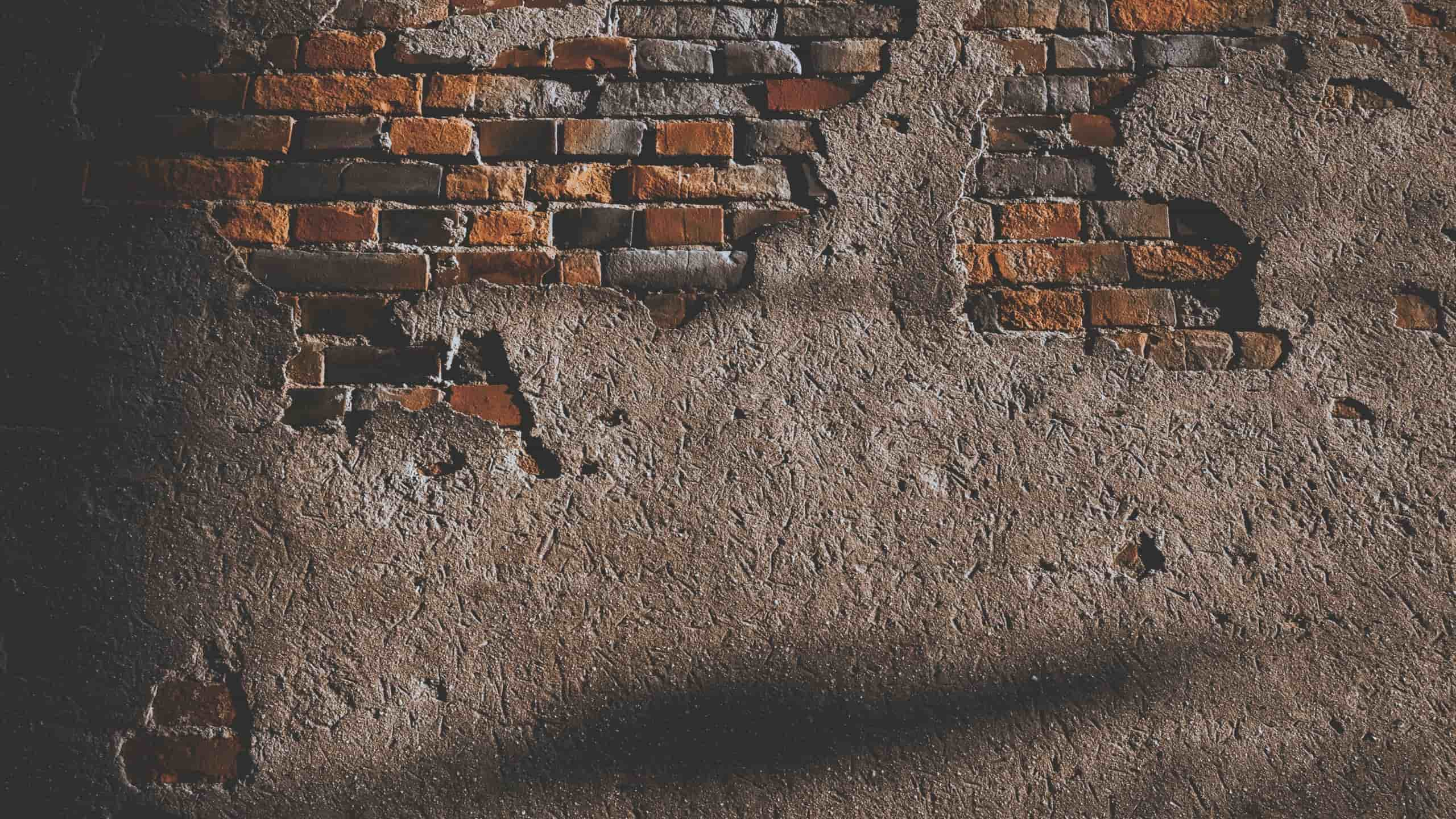 Wall with broken bricks